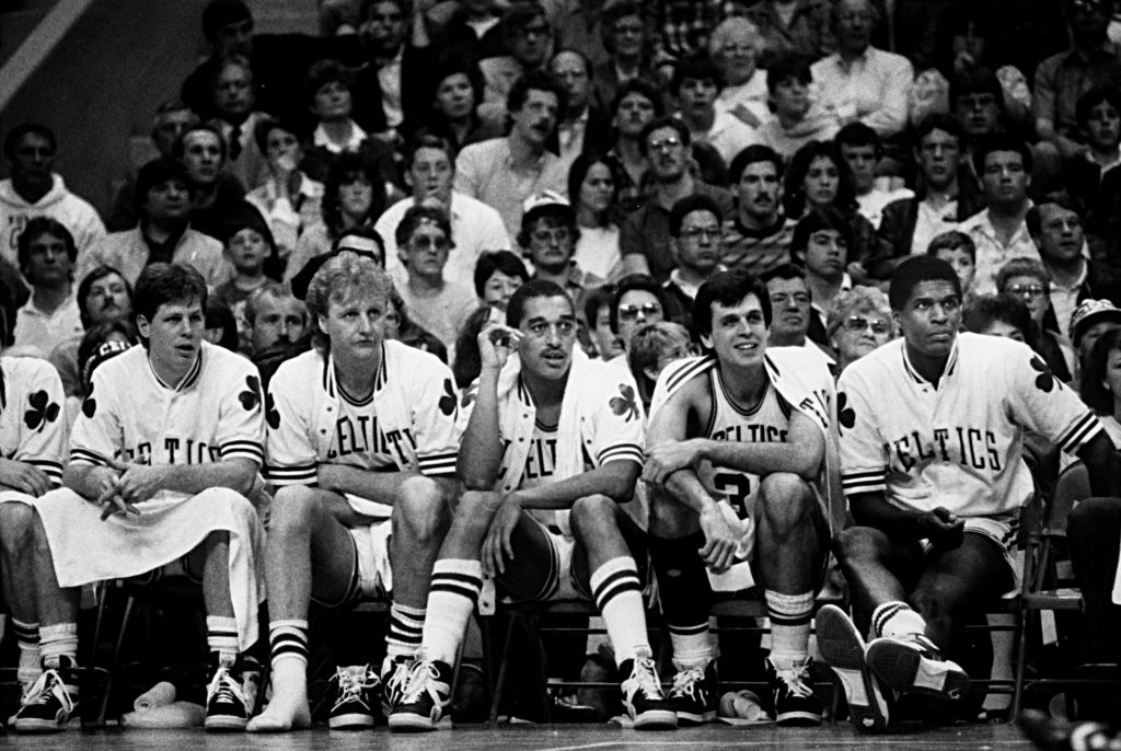 BOSTON - APRIL 13: The Boston Celtics' 1985-86 championship starters, Danny Ainge, Larry Bird, Dennis Johnson, Kevin McHale, and Robert Parish sit on the bench during a game against the New Jersey Nets at Boston Garden on April 13, 1986. (Photo by John Blanding/The Boston Globe via Getty Images)
