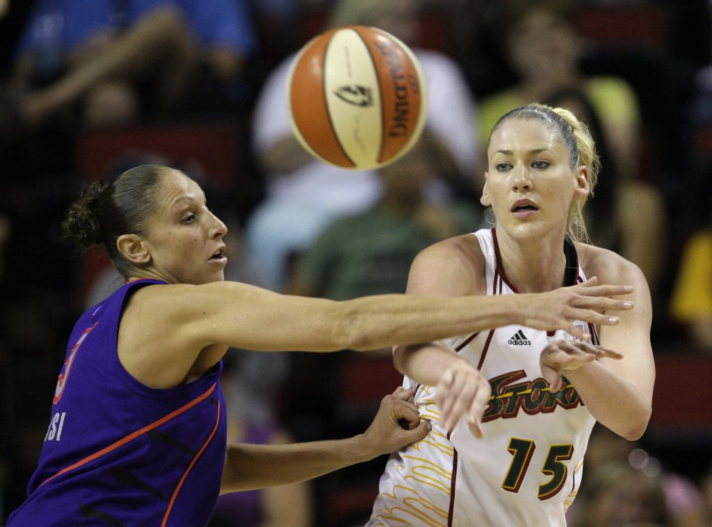 FILE - In this Aug. 4, 2009, file photo, Seattle Storm's Lauren Jackson (15) passes as Phoenix Mercury's Diana Taurasi defends in a WNBA basketball game in Seattle. The two-time WNBA MVP and Australian superstar re-signed Thursday, March 11, 2010, with the Storm in a multiyear contract, the team announced. This spring, Jackson will begin her 10th season in the league with the same team that welcomed her to the United States and set her on her way to becoming one of the top faces and forces of the WNBA. (AP Photo/Elaine Thompson, File)
