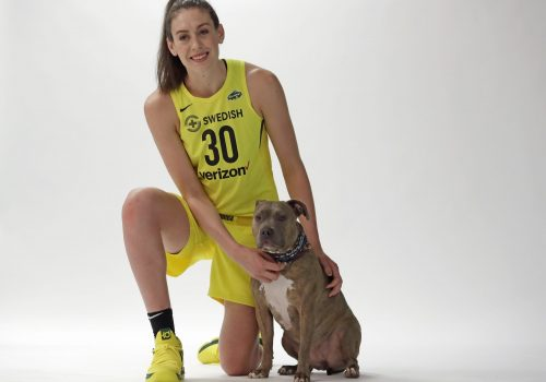 Former WNBA MVP Breanna Stewart poses for a photo with her dog Spicy