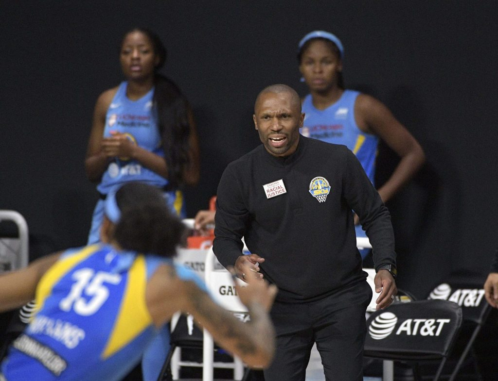 Chicago Sky head coach James Wade, center, calls out instructions during WNBA game in the Wubble