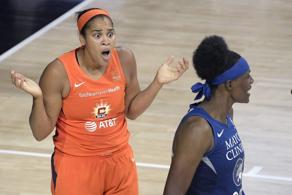 Connecticut Sun center Brionna Jones, left, reacts after being called for fouling Minnesota Lynx center Sylvia Fowles, left, during the second half of a WNBA basketball game, Sunday, July 26, 2020, in Bradenton, Fla. (AP Photo/Phelan M. Ebenhack)
