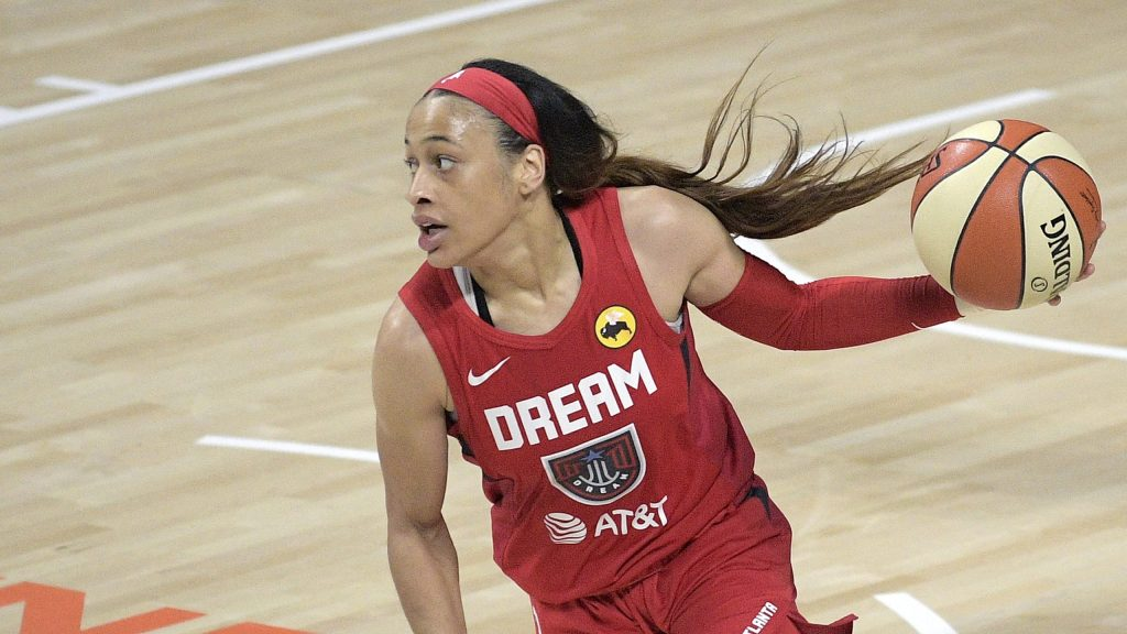 Atlanta Dream guard Chennedy Carter brings the ball up the court during the second half of a WNBA basketball game against the Dallas Wings, Sunday, July 26, 2020, in Bradenton, Fla. (AP Photo/Phelan M. Ebenhack)