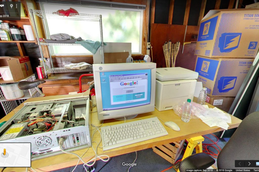Google original home with computer and boxes