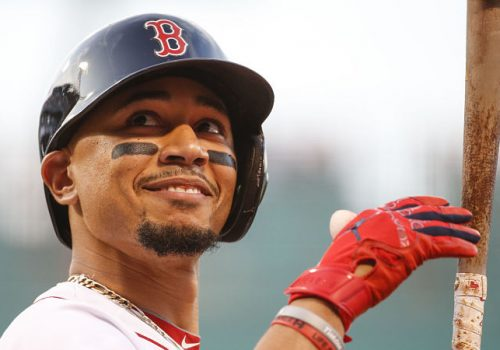 Mookie Betts smiling with a bat