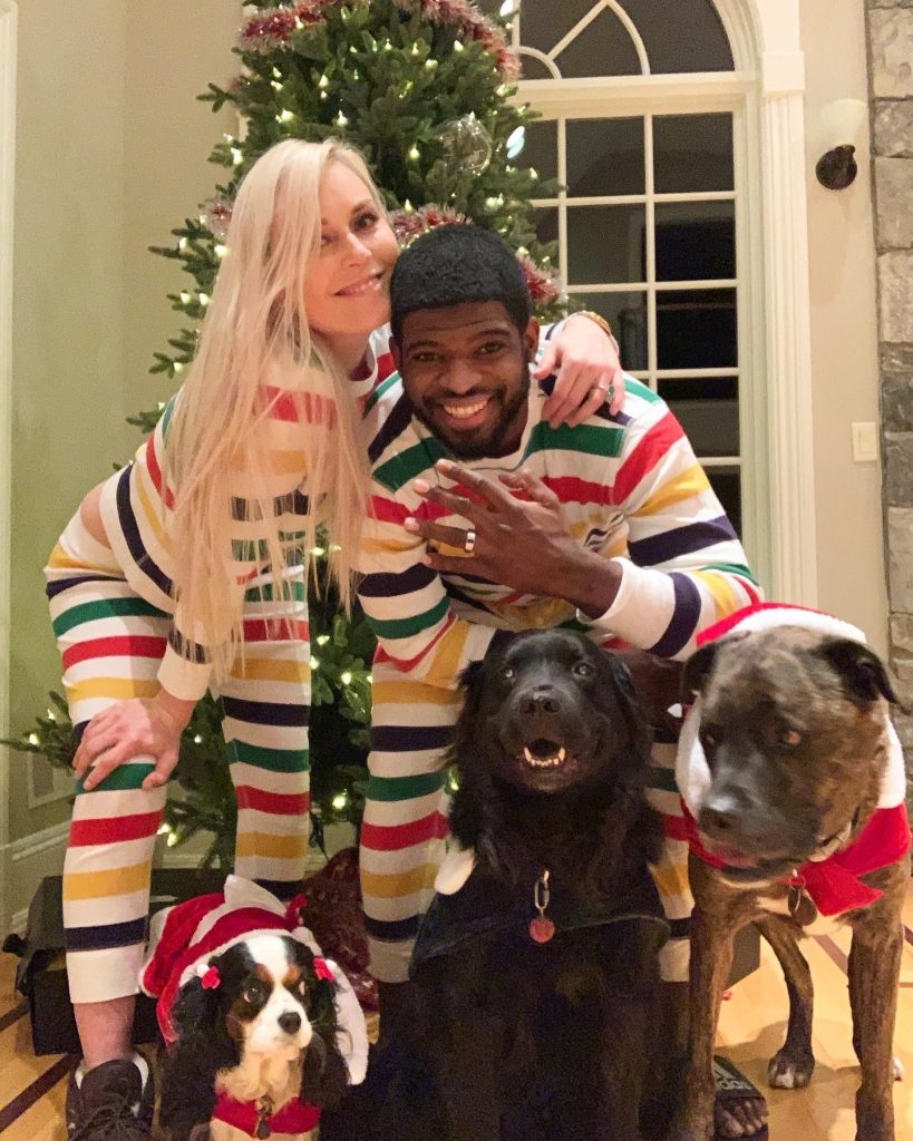 Lindsey Vonn and P.K. Subban in striped pajamas with their dogs