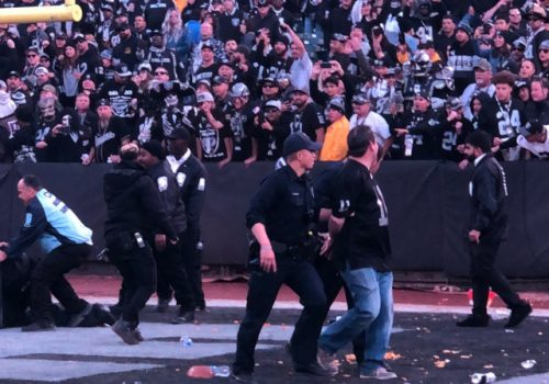 Raiders fans throwing trash onto the field